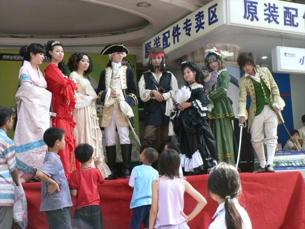 Actors promote a new mobile phone shop, Chengdu, Sichuan Province, China