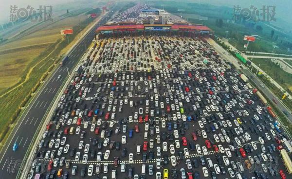 National Holiday when roads are toll free. Cars queuing to get on the Beijing-Shanghai expressway