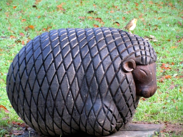 Carved sheep with bird, Trelissick Gardens, Cornwall. Dec 2012