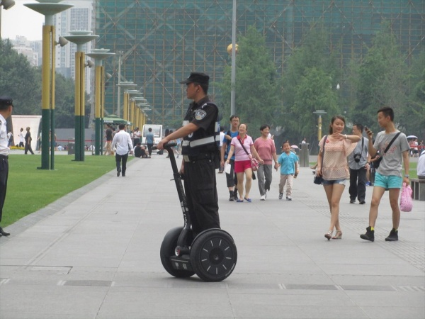 The main square Chengdu,  June 2013. Is this a Segway?