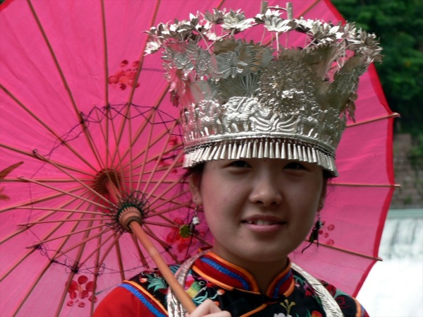 Phoenix Town - Dressing up in minority nationality costumes is so popular in China.