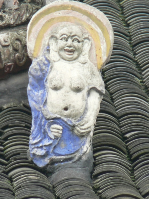 Laughing Buddha, but not gloating
