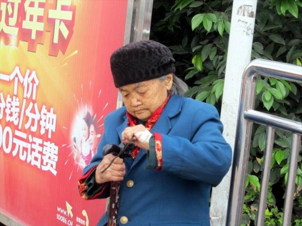 Waiting for the bus, Wansheng, Sichuan Province, China. April 2013