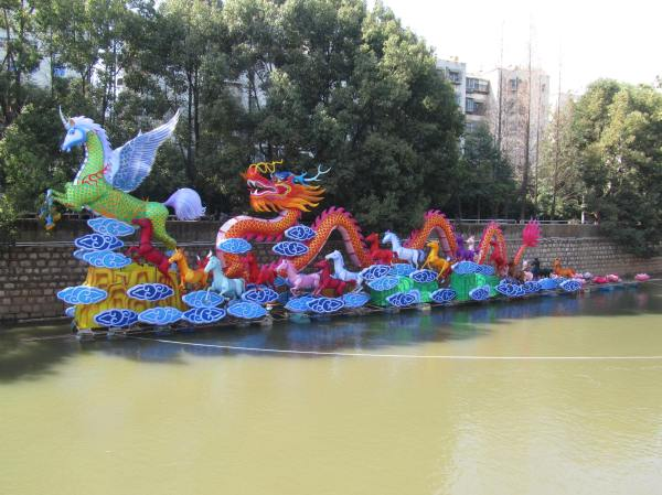 Preparing for the Year of the Horse, floating river display, Yunnan Province, China, January 2014