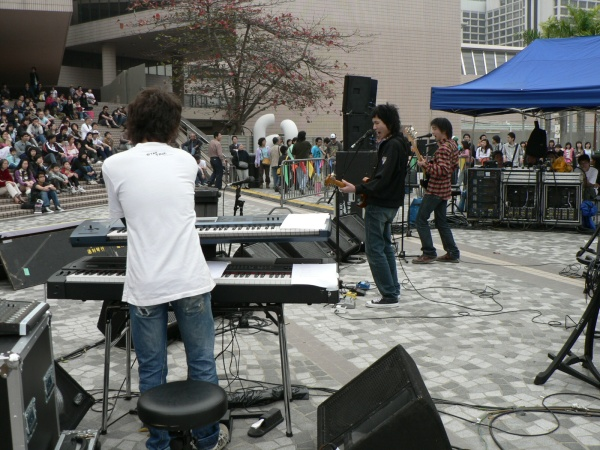 Young musicians perform on the former land-grabbed  Hong Kong waterfront, March 2006