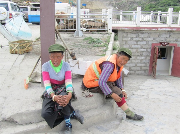 Taking abreak from street cleaning, Shangri La village, Sichuan, May 2013