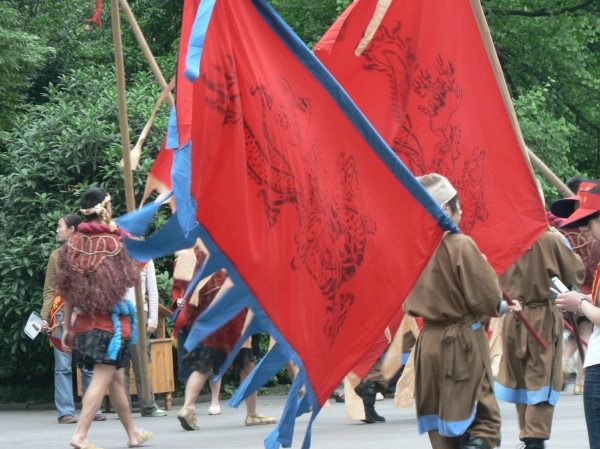 The Dujiangyan scenic area - flag wavers and dancers preparing to perform